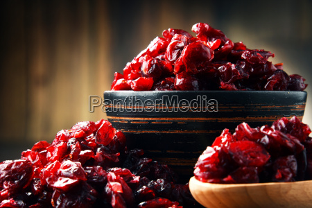 composition with bowl of dried cranberries