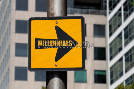directional sign with conceptual message millennials