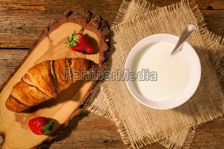 continental breakfast with croissant strawberries and