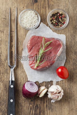 raw steak on wood