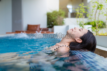 woman enjoy and relaxing on jacuzzi