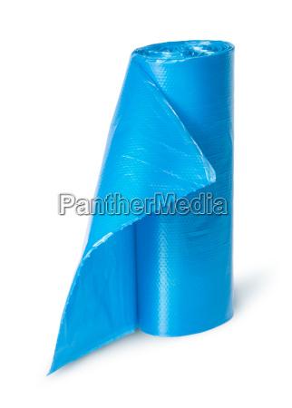vertical roll of blue plastic garbage