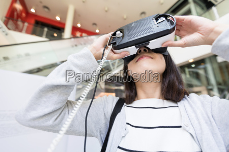 woman trying virtual reality in museum