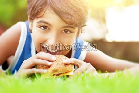 happy boy eating burger