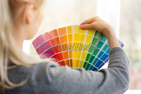 woman designer choosing interior design color