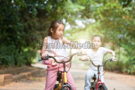 children biking outdoor