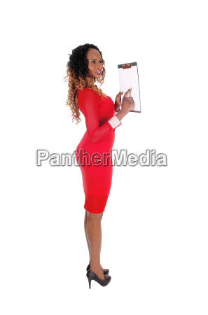 pretty woman showing on clipboard