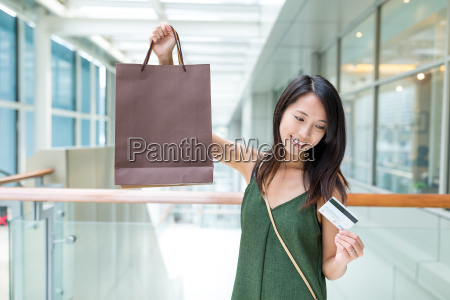 woman using credit card and holding