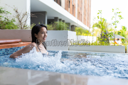 woman enjoy the jacuzzi spa in