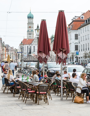 people at a street cafe in