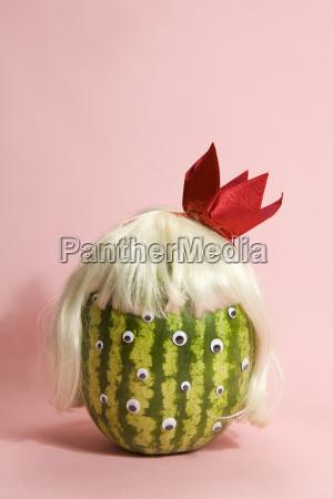 freak watermelon wearing a wig