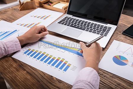 businesswoman analyzing business graph