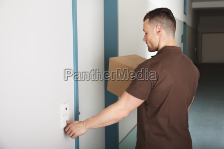 delivery man ringing the door bell