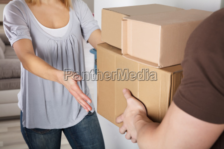 delivery man giving parcel box to