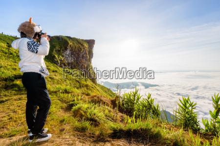 hiker teen girl photographing