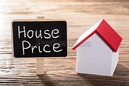text house price written on blackboard