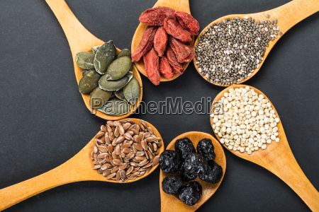 superfoods in a wooden spoons