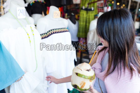 woman enjoy coconut juicy and shopping