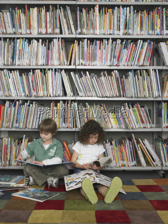 boy and girl reading books in