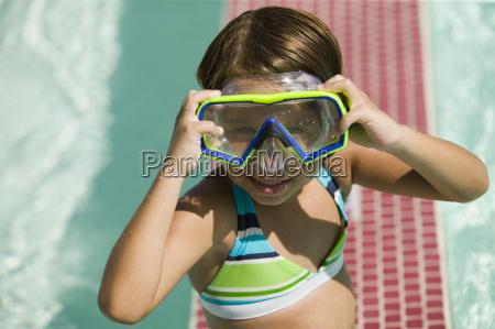 girl 7 9 adjusting goggles in
