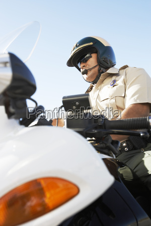 police officer sitting on motorcycle