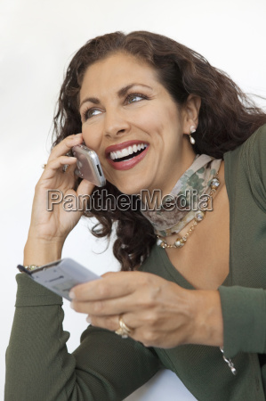 woman using cell phone and pda