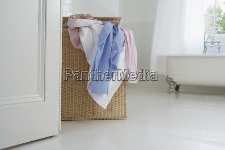 overflowing wicker laundry basket
