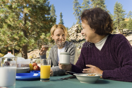 women eating at picnic table in