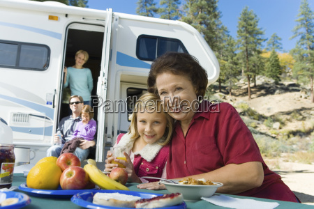 three generation family outside rv in