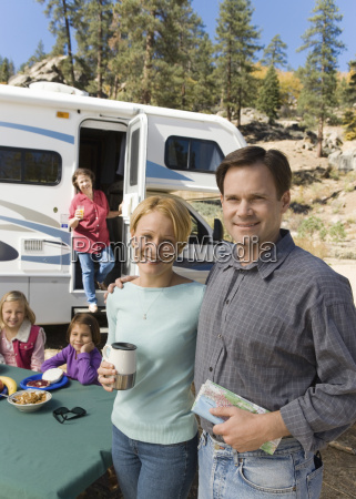 couple and family outside rv in