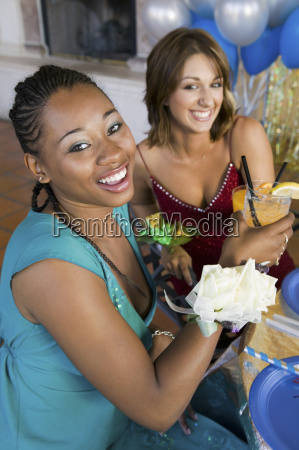 well dressed teenage girls drinking at