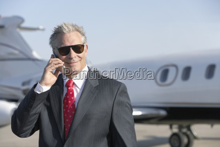 businessman using cell phone with private