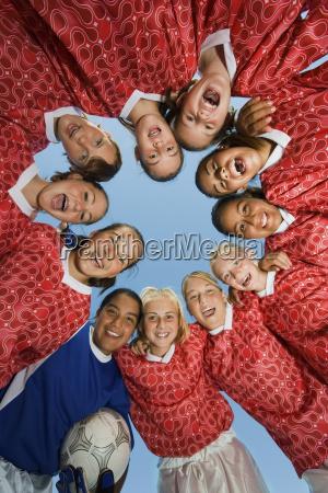 girls soccer team in huddle