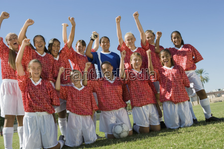 excited female soccer players