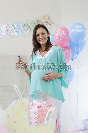 happy pregnant woman at a baby