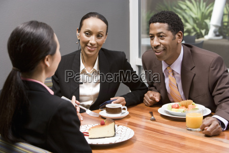 business people having discussion during their