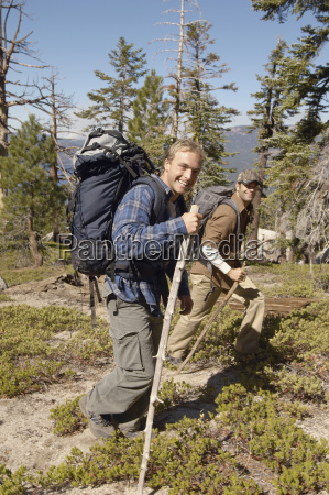 mid adult men hiking together