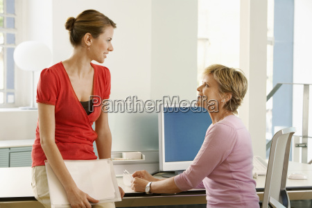 business woman discussing at desk