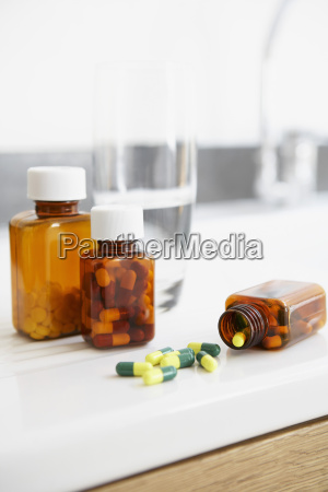 spilt bottle of pills on counter