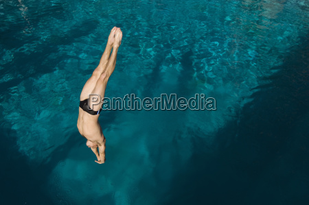man diving into the pool