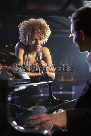 singer and pianist on stage