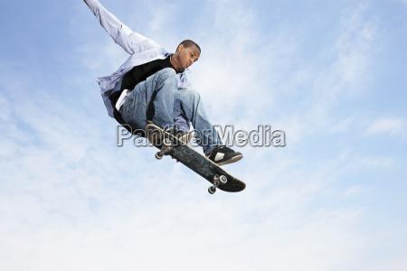 man on skateboard in midair