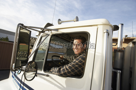 mature man driving truck