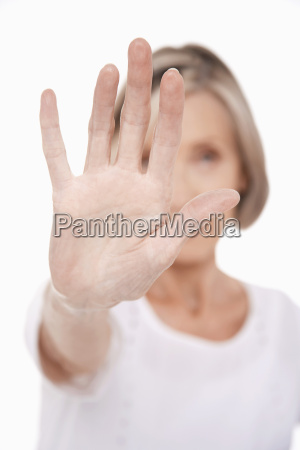 senior woman holding out palm