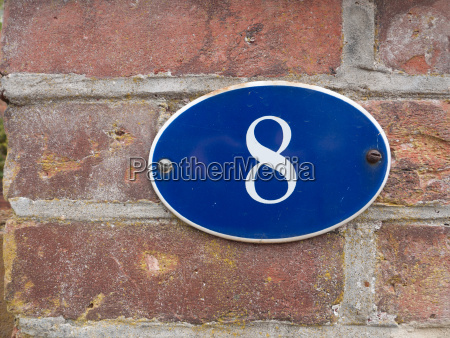 a house number plate outside blue