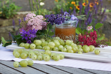 summer ambience with gooseberries on wooden