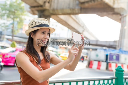 woman taking photo in bangkok city