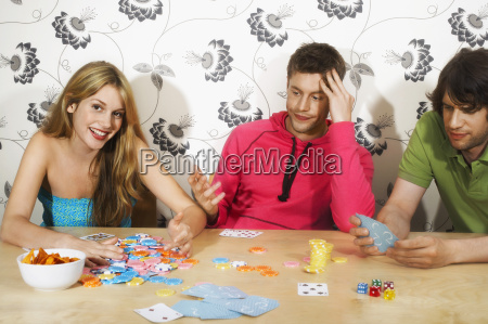 friends playing cards as woman wins