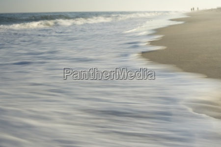 wave washing on shore blurred motion