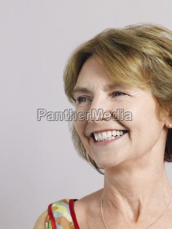 smiling senior woman looking away